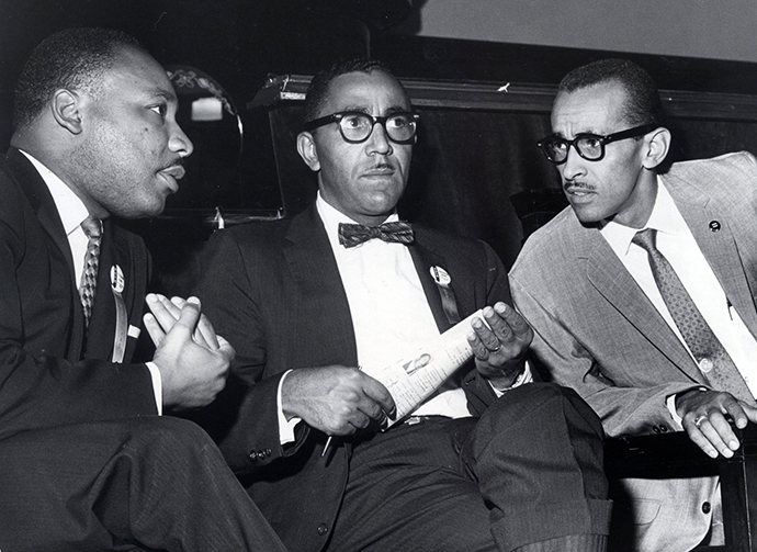The Rev. Martin Luther King Jr. (from left), Joseph E. Lowery, Vice President of the Southern Christian Leadership Conference, and Wyatt Tee Walker, Executive Director, meet at First African Baptist Church in Richmond, Virginia, Sept. 25, 1963, for the SCLC convention. Photo by Carl Lynn, Richland Times-Dispatch.