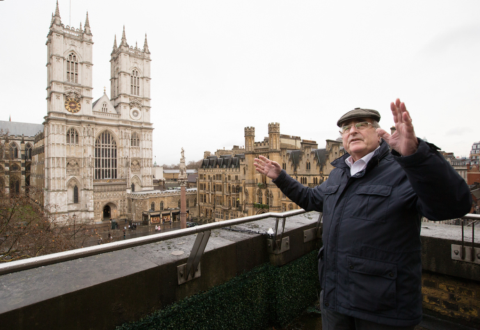 Frank Waller points out London landmarks from the balcony of Methodist Central Hall, Westminster, including Westminster Abbey (left background). Waller is assistant visitor services manager for Methodist Central Hall. Photo by Mike DuBose, UMNS.