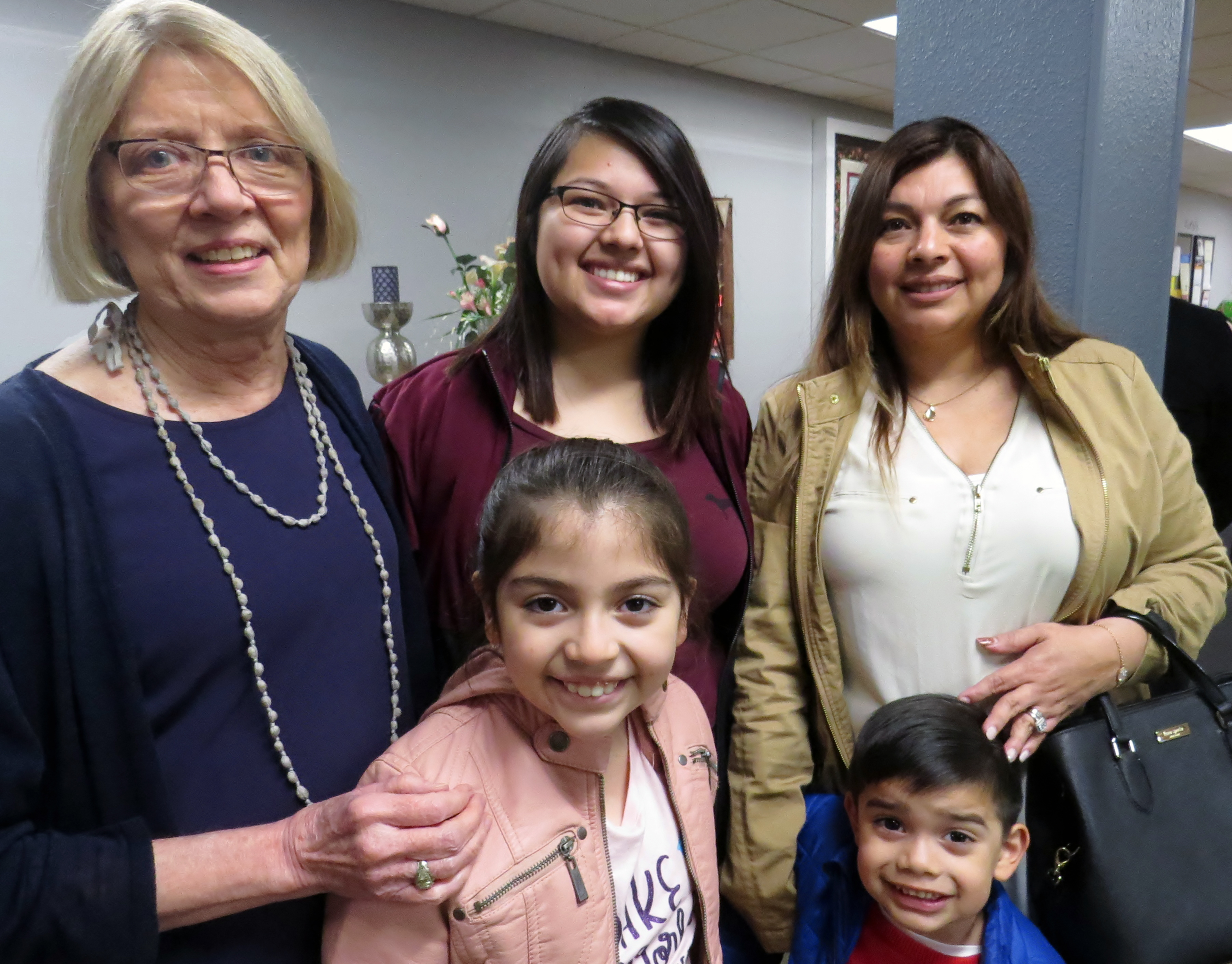 Kay Schecht has been a mentor to three generations of the Lopez family in Irving, Texas. She stands with Dalia Lopez (far right) and Dalia's daughter, Selena, and in front are Selena's children Mia, 8, and Ethan, 4. Schecht received the Foundation for Evangelism's Distinguished Evangelist Award in recognition of more than 20 years of service to at-risk children and youth. Photo by Sam Hodges, UMNS.
