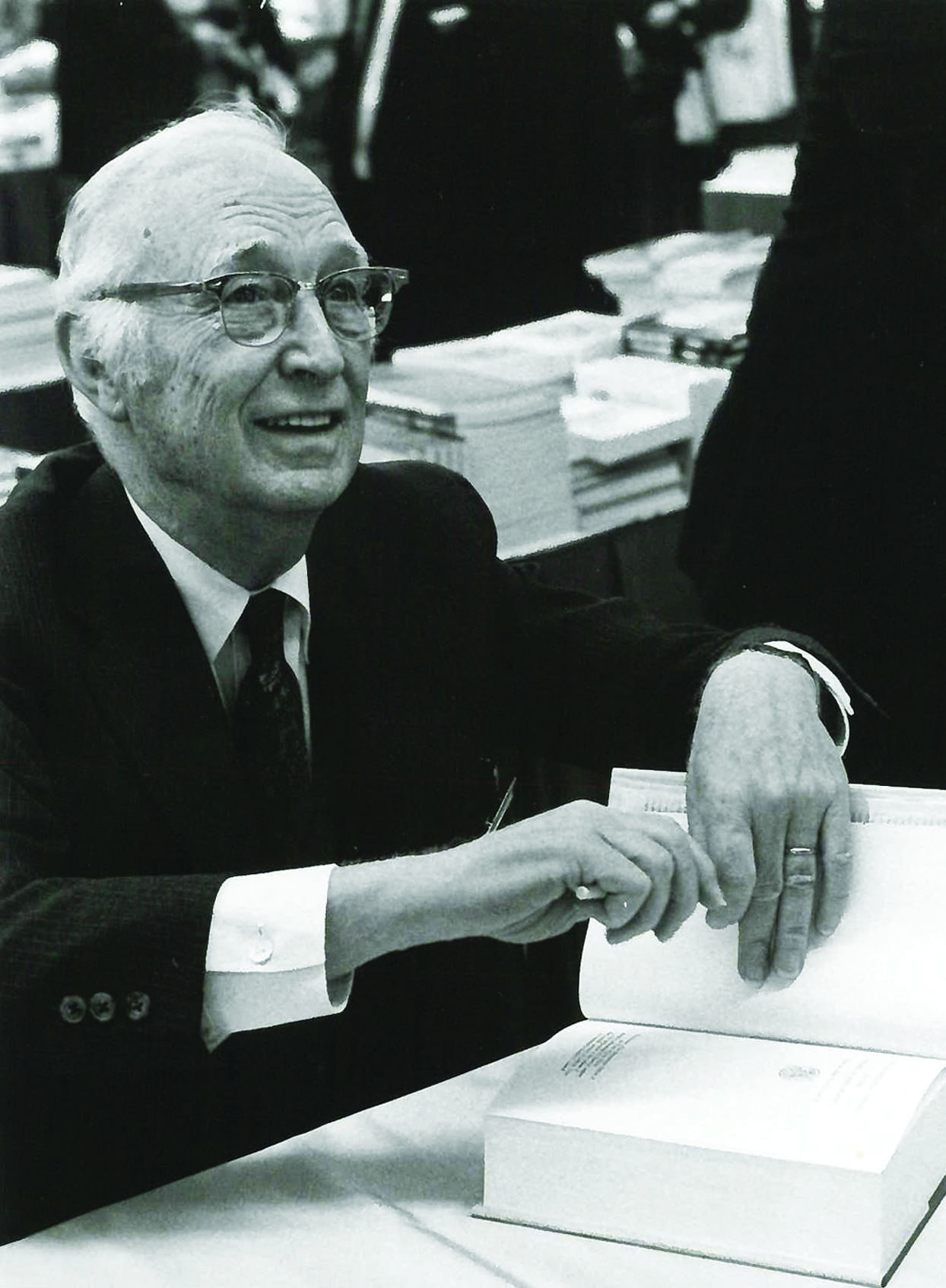 An undated publicity photo shows the Rev. Albert C. Outler autographing books. Outler was chosen to preach for the uniting service of the 1968 Uniting Conference, which saw the creation of The United Methodist Church. Photo courtesy of Steve Beard, Editor in Chief, Good News.