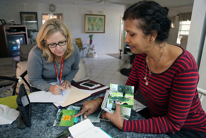 The Rev. Laura Ice (left), recovery coordinator for the Florida Conference, works through claim paperwork with Nirmala Narayan in February. Narayan's home in Sebring was the first case opened by the conference's case managers in Central Florida after Hurricane Irma devastated the area. Photo by Deborah Coble, Florida Conference.