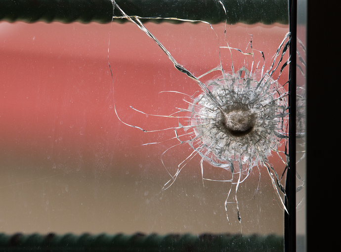 A bullet hole in a newsroom window at The Voice of Hope serves as a reminder of election-related violence in 2011. The station remained on the air during the crisis and several staffers took shelter there. Photo by Mike DuBose, UMNS.