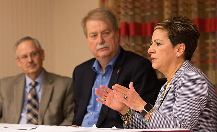 Bishop Cynthia F. Harvey (right) answers questions during a press conference about the United Methodist Church's Way Forward plan to address how the denomination ministers with LGBTQ individuals at the conclusion of the church's Council of Bishops meeting in Chicago. She is flanked by Bishops Bruce R. Ough (left) and Kenneth H. Carter. Photo by Mike DuBose, UMNS.