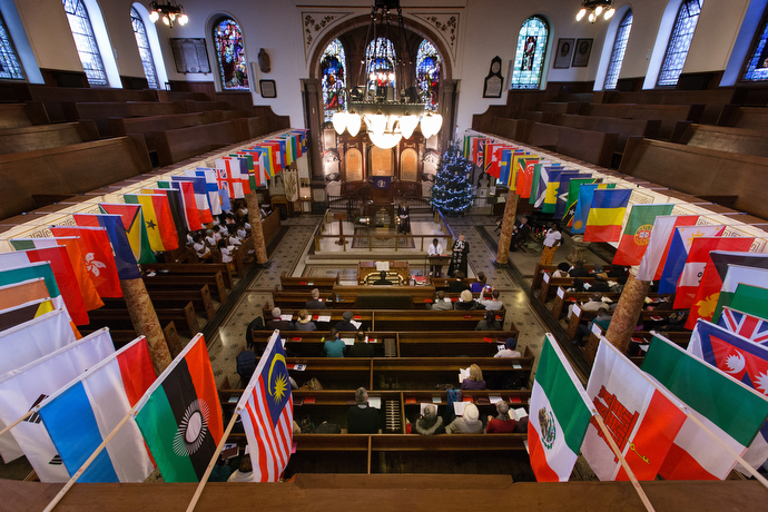 Flags of the nations represented by the diverse congregation of Wesley's Chapel ring the balcony of the historic church. Photo by Mike DuBose, UMNS.