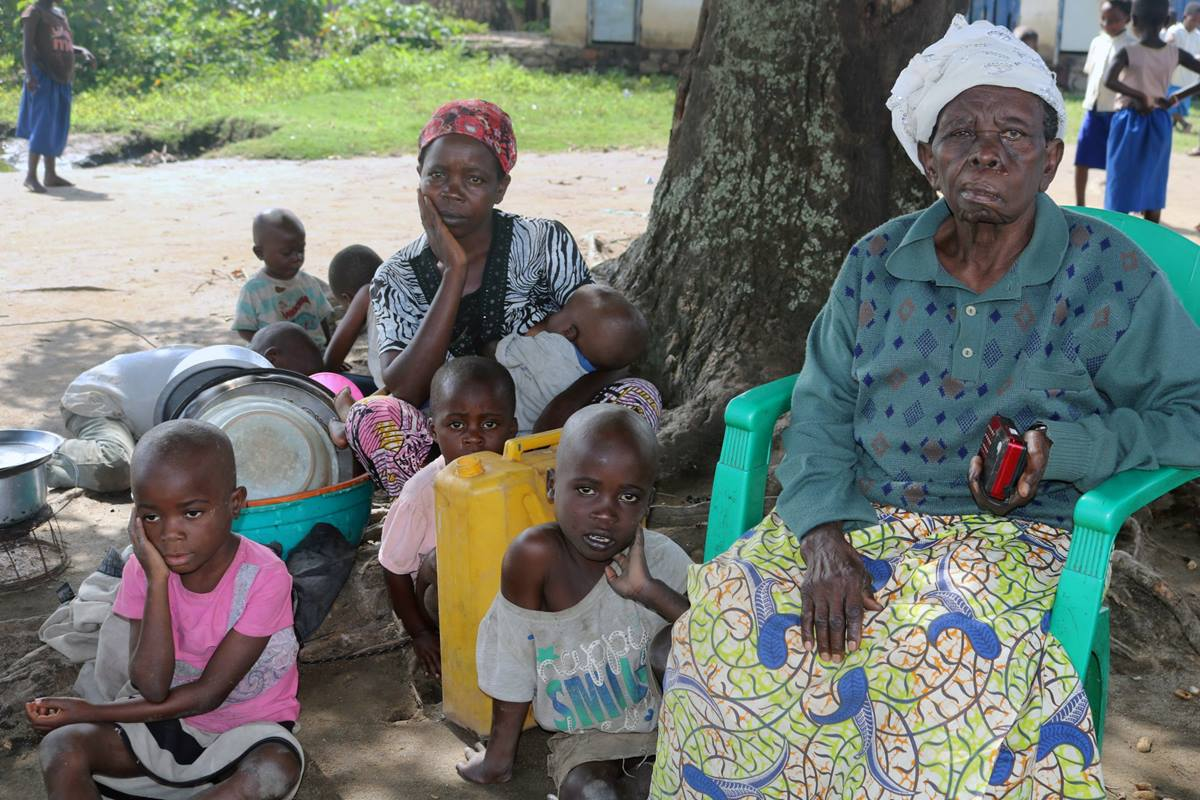 Bembeueza Solonge (center, holding baby) and her family make their home under a tree for lack of shelter after flooding in Kivu, Congo. Nine people have died and thousands of homes and buildings have been destroyed, including United Methodist schools and churches. Photo by Philippe Kituka Lolonga, UMNS.
