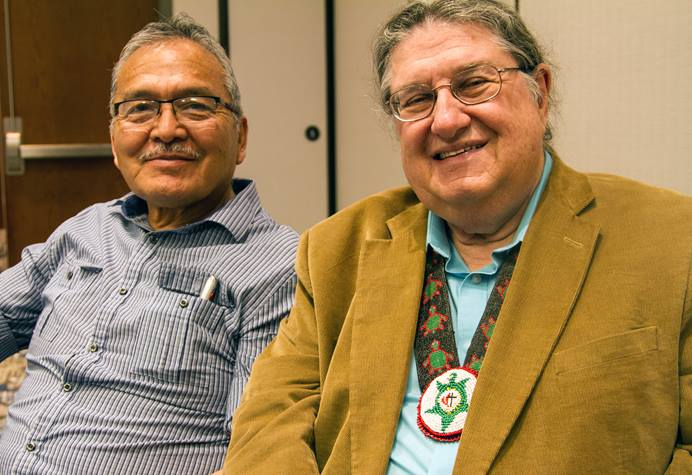 Norman Mark (left) and the Rev. Fred Shaw, director of the Native American Course of Study, talk about why it is important for Native pastors to blend traditional language and culture in ministry. Photo by Ginny Underwood, UMNS
