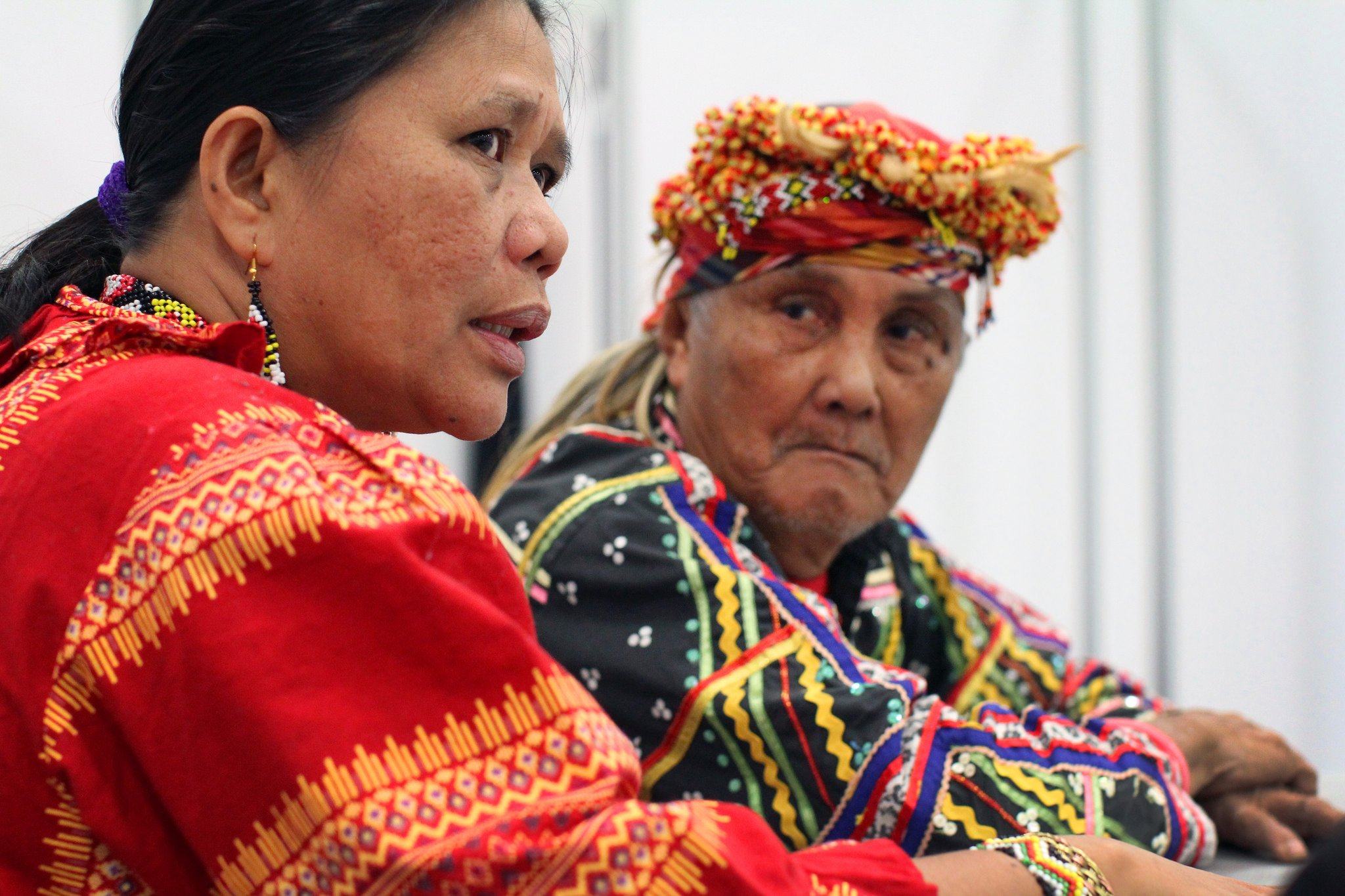 Norma Capuyan and Monico Cayon, indigenous leaders from the island of Mindanao in the southern Philippines, answer questions in the news area at the 2016 United Methodist General Conference at the Oregon Convention Center in Portland. Both shared experiences of discrimination and are part of the Lakbay Lumad USA tour.  Photo by Kathleen Barry, UMNS.