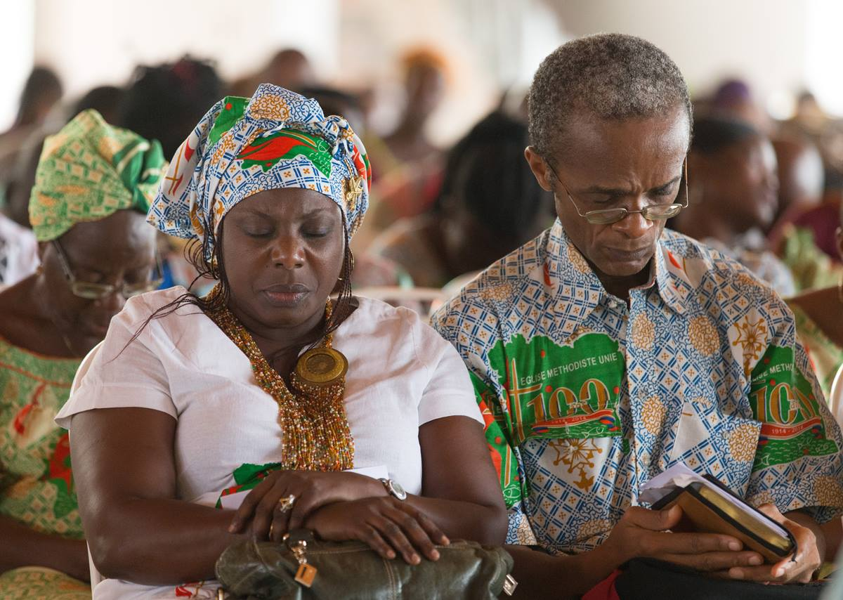 Parishioners pray during worship at Canaan United Methodist Church in Abidjan, Côte d'Ivoire, in February 2018. Photo by Mike DuBose, UMNS.
