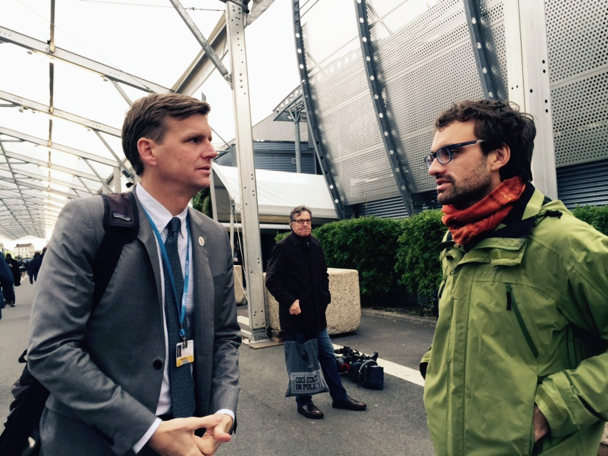 John Hill, a staff member of the United Methodist Board of Church and Society, and Daniel Obergfell, a Church and Society board member from Germany, at the 2015 U.N. climate change summit in Paris. Both are part of a United Methodist delegation to the Nov. 6-17 Bonn climate summit, also known as COP 23. File photo by the Rev. Lisa Garvin.