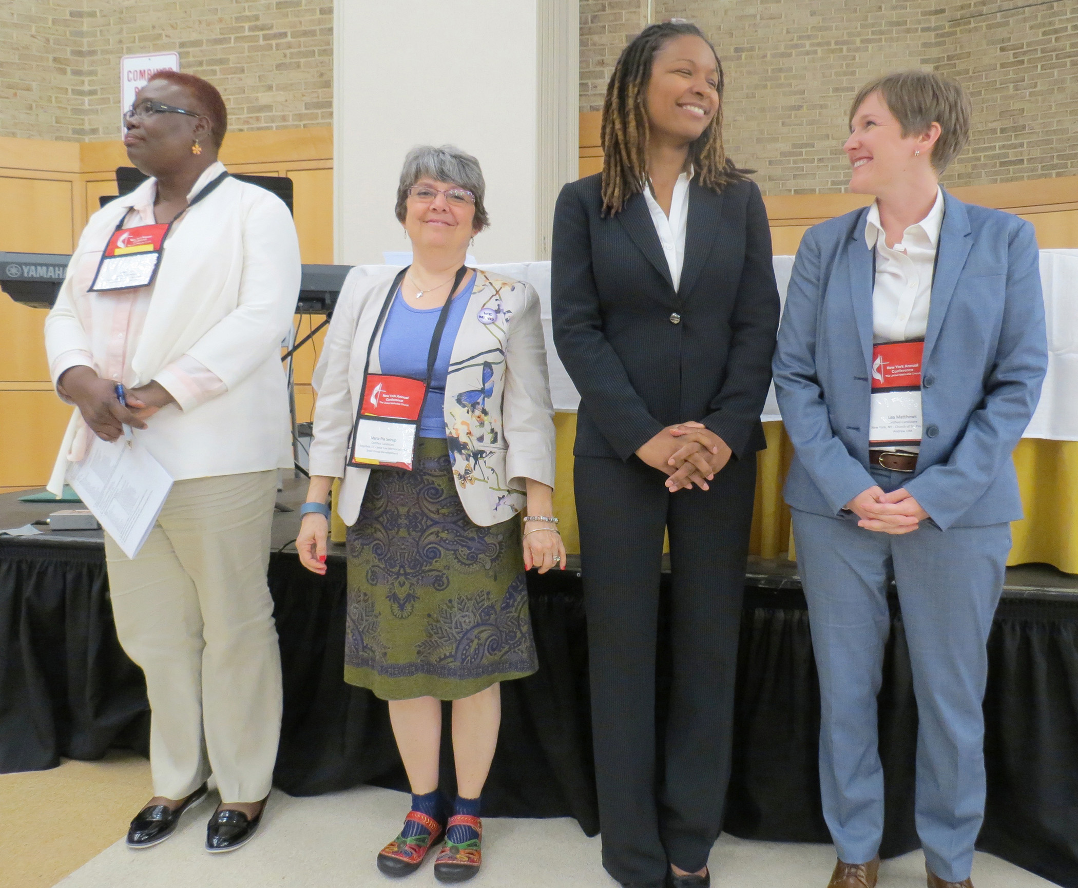 Elyse Ambrose, second from right, and Lea Matthews, far right, were among group approved as provisional deacons by the New York Conference. Photo by Joanne Utley
