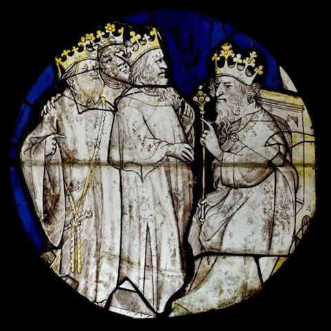 The three wise men appear before King Herod in this stained-glass window by an anonymous artist. Despite their crowns, the magi were not kings in the Bible. A web-only public domain image.