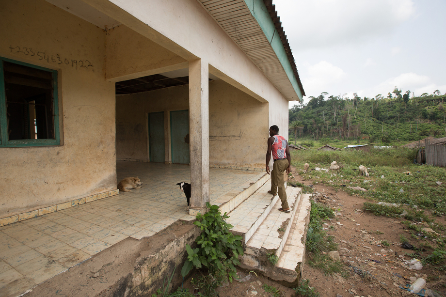 Boh Lion, a fisherman and village elder, walks up the steps of the abandoned health clinic in Monogaga. Lion says the clinic has not been used since the doctor left some years ago.