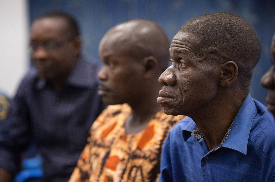Health workers watch a video presentation about preventing the spread of Ebola in Man.