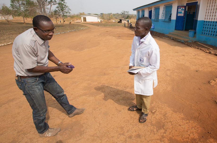 Dr. Simplice Adouko (left) bows in greeting to nurse Joelin Gba Nica at the Centre de Santé Urbain hospital in Sipilou, Côte d'Ivoire, along the border with Guinea. Polite bows have replaced handshakes in much of Côte d'Ivoire at the urging of health officials concerned about possible spread of the Ebola virus.