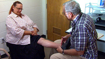 A patient is treated at the Shepherd's Hope medical clinic.