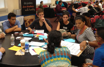 Yolanda M. Santiago and other young adults share in their small group session.