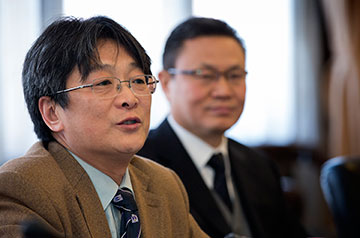 The Revs. Kan Baoping (left) and Gao Feng of the China Christian Council discuss relations with The United Methodist Church during a meeting with a visiting delegation of denominational leaders at the council's office in Shanghai, China.