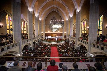 Parishioners fill the pews during worship at Mu'en Church in Shanghai, China.