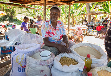 Sylviane Jean Baptist, 42, sells food from her market stall in Mizak, Haiti. She is one of the first clients of the microcredit program at Haiti Artisans for Peace International.
