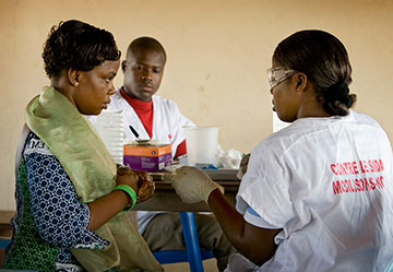 Cecile Ahimin Aya (left) has an HIV test during a public health screening at the Jerusalem Parish United Methodist Church in Yamoussoukro, Côte d'Ivoire, in November 2008.