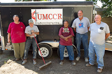 A United Methodist Volunteers in Mission Team from the Indiana Annual (regional) Conference helped homeowner Edward Ortiz (center) gut the interior of his Minot, N.D., home and clean up after flooding in June 2011. A UMNS file photo by Mike DuBose.