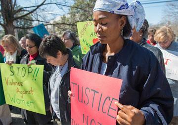 The Rev. Eunice Musa Iliya (right) participates in an International Women's Day vigil, sponsored by United Methodist Women. Photo by Kristina Krug, courtesy of United Methodist Women.
