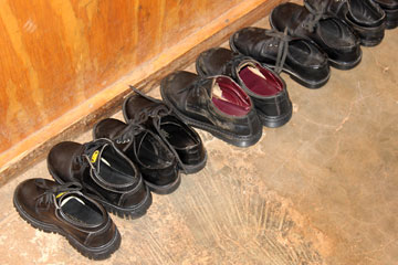Shoes of the preschoolers are lined up awaiting the end of nap time. A UMNS photo by Emmauel Taurai Maforo.