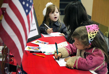 Children at First United Methodist Church of Lancaster, Pa., write thank-you notes to give to wounded veterans and those serving in the military.
