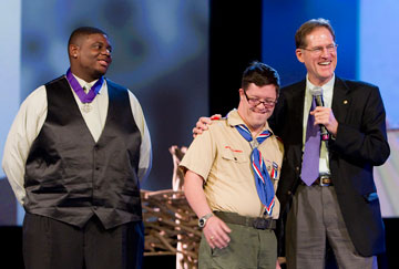 Boy Scouts Justin Jackson (left) and Ryan Wilson receive The United Methodist Church's Good Samaritan Award from Larry Coppock during the 2012 United Methodist General Conference in Tampa, Fla. Coppock is director of Scouting Ministries at the Commission on United Methodist Men. A UMNS photo by Mike DuBose.