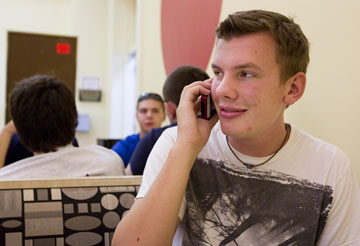 Freshman Andy Wegg keeps in touch with friends and family via smartphone at the University of Indianapolis. A UMNS photo by Mike DuBose.