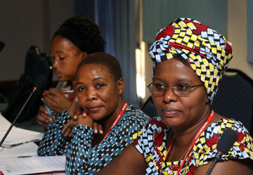 (From left) Mercy Nyirongo, Malawi; Hannah Mafunda, Zimbabwe; and Marie-Therese Nijimbere, Burundi, listen as experts in grant writing teach health board members the process.