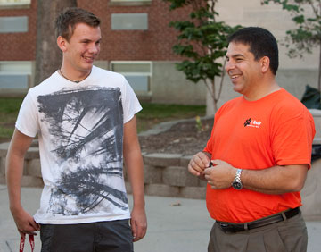 University of Indianapolis freshman Andy Wegg shares a laugh with school president Robert Manuel during the school's Freshman Move-In Day.