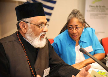 Evelyn Parker, U.S., and the Rev. Kondothra M. George, from the Malankara Orthodox Syria Church in India, lead a Bible study at the recent World Council of Churches Central Committee meeting in Crete. A web-only photo courtesy of World Council of Churches/Mark Beach.