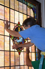 Stained-glass artist Lou Ellen Beckham-Davis of LEB Glass works on a window at St. George church.