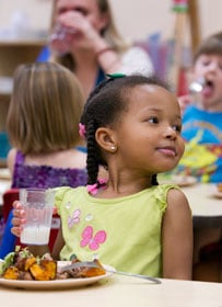 Zahra Ansari enjoys a healthy lunch at West End United Methodist Church's preschool in Nashville, Tenn. A UMNS photo by Mike DuBose.