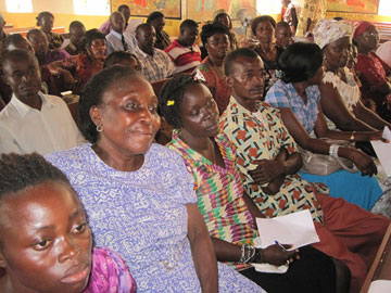 Teachers at the training listen attentively.