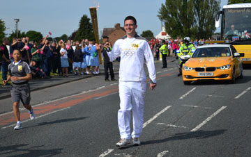 Olympic torchbearer Tom Clayton was nominated for the privileged task by his pastor, the Rev. Sue Pegg, at St. John's Methodist Church in Shieldfield, England. Photo by Mel Pegg.