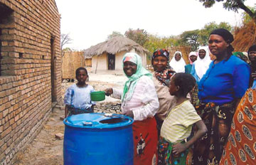 Women in Malawi observe a cleansing with water before prayer in the mosque.