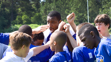 NFL football player Chris Canty started the Chris Canty Camp of Champions Football Camp, which encourages children and youth to strive to do their best. A web-only photo courtesy of the Chris Canty Foundation.