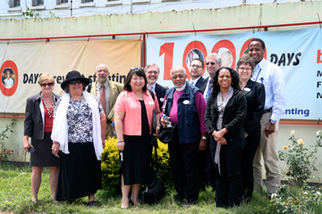 June Kim of the United Methodist Committee on Relief (center, in peach jacket) and others visited three African countries last October as part of a trip sponsored by Bread for the World related to the