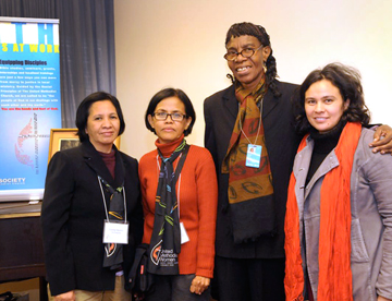 From left, Estrelita Mariano and Teresita Vistro of the Philippines, Nelcia Hazell of St. Vincent in the Caribbean and Ana Chã of Brazil greet each other after a panel discussion at the Church Center for the United Nations.