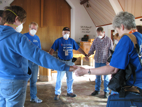 Volunteers gather in prayer inside the sanctuary of Faith United Methodist Church in Minot, N.D., following the flooding of 2011.  UMNS photos by Doreen Gosmire.