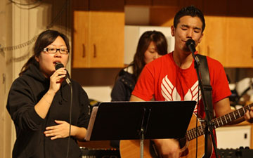 Cindy Chang, left, sings during an event at Korean United Methodist Church in San Jose, where she is an active member and lay deacon. After growing up in the U.S., she is facing deportation to Korea.
