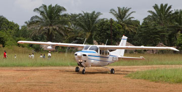 Gaston Ntambo taxis the Wings of the Morning plane off the dirt runway in Kamina. A UMNS photo by Mike DuBose.