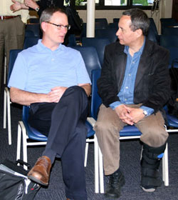 The Rev. Adam Hamilton (left) speaks with Neil M. Alexander before a report on the Call to Action effort to the Council of Bishops. Hamilton and Alexander are members of the Interim Operations Team, a group of clergy and laity charged with building on the Call to Action recommendations.