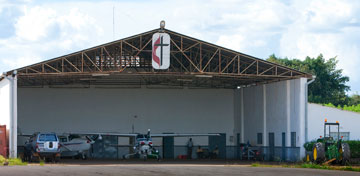 The United Methodist Cross and Flame marks the Wings of the Morning hangar at Lubumbashi International Airport. A UMNS photo by Mike DuBose.