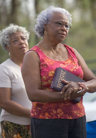 Atha Brown (right) and Victoria Alfred sing during an outdoor worship service in Slidell, La., in 2005. A UMNS file photo by Mike DuBose.