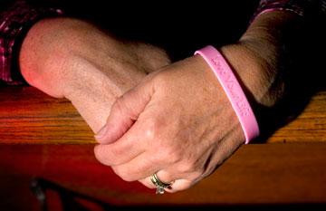 Mamie Jeter wears a wristband proclaiming