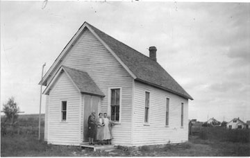 Congregants gather outside of the Methodist Episcopal Church in Gladstone, N.D., in this circa 1933 photo. A UMNS photo courtesy of the Archives of the Dakotas Conference of the United Methodist Church.
