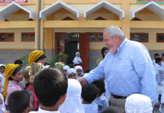 The Rev. Sam Dixon greets children in Indonesia in this file photo.A Web-only photo courtesy of UMCOR.